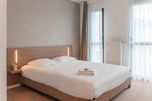 Un ou plusieurs lits dans un hébergement de l'établissement Appart'City Angers