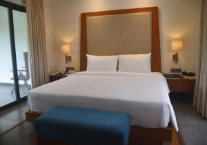 A bed or beds in a room at Radisson Blu Resort & Spa Alibaug