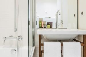 Um banheiro em Hotel Joke - Astotel