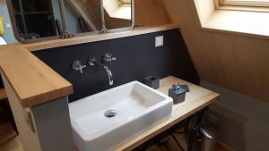 Salle de bains dans l'établissement Le Clos des Songes