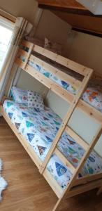 A bunk bed or bunk beds in a room at Mona Villa Holiday Let