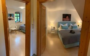 Ein Bett oder Betten in einem Zimmer der Unterkunft Landappartement Stritter