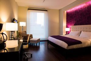 Cama ou camas em um quarto em Ramada Plaza by Wyndham Panama Punta Pacifica