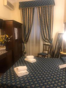 Een zitgedeelte bij Bye Rome Guesthouse