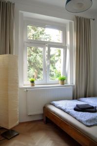 Postel nebo postele na pokoji v ubytování Central-Modern-Apartment