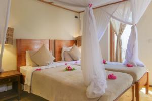 Cama o camas de una habitación en Jambiani Villas