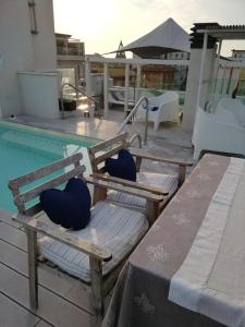 The swimming pool at or near Hotel Madalù