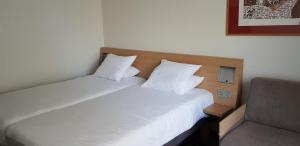 A bed or beds in a room at Novotel Narbonne Sud A9/A61