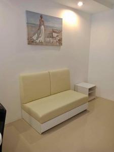 A seating area at The Royal Place Condominium 3 Phuket