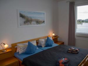 Postel nebo postele na pokoji v ubytování 015 Fewo Abrams Wilhelmshaven