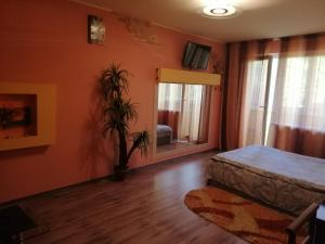 A bed or beds in a room at Zhytomyr Apartments
