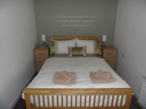 A bed or beds in a room at The Corner House Hotel