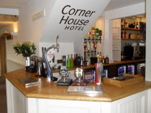 The lounge or bar area at The Corner House Hotel