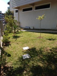 A garden outside Laghetto Vacanze - Residencial Villa di Favero