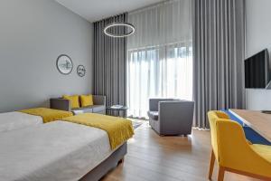 Una televisión o centro de entretenimiento en Hotel Number One by Grano