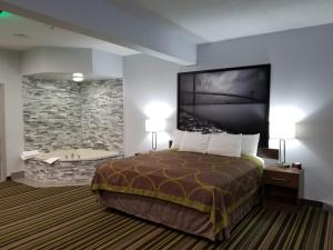 A bed or beds in a room at Super 8 by Wyndham Windsor/Dougall