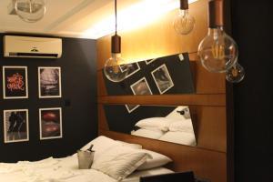 Cama ou camas em um quarto em Status Motel