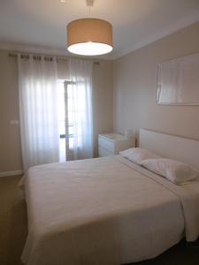 Uma cama ou camas num quarto em Vila EMA