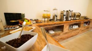 Una cocina o zona de cocina en Hotel Vento