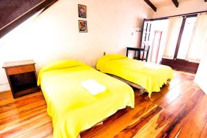 Letto o letti in una camera di Hostal CasArte Takubamba