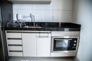 A kitchen or kitchenette at Beach Class, Ilha do Leite, Flat