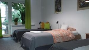Łóżko lub łóżka w pokoju w obiekcie Animrumru
