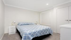 A bed or beds in a room at 28 Kentia