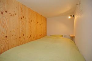 温泉ゲストハウス 湯kori ドミトリーにあるベッド