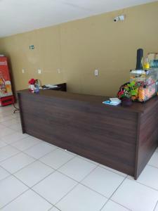 The lobby or reception area at Pousada Pilotos