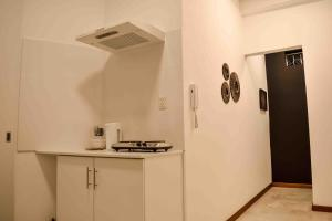 A kitchen or kitchenette at Figari Guest House