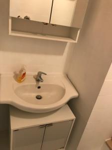 A bathroom at Sunshine Apartment 7