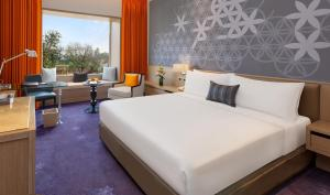 A bed or beds in a room at WelcomHotel Amritsar - Member ITC Hotels