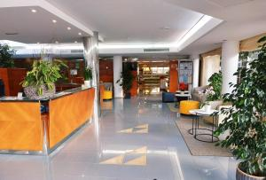 El vestíbulo o zona de recepción de Hotel Capricho