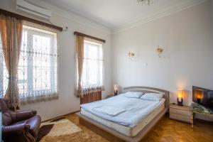 A bed or beds in a room at Kutaisi Hotel California