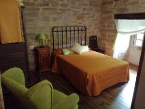 A bed or beds in a room at La Posada de Pedrazales