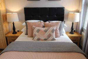 A bed or beds in a room at The Larches