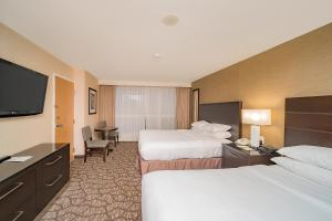 A bed or beds in a room at Embassy Suites by Hilton Niagara Falls/ Fallsview