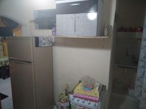 A kitchen or kitchenette at Kitnets da Tia Zeni