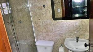 Um banheiro em Recanto Monte Suíço