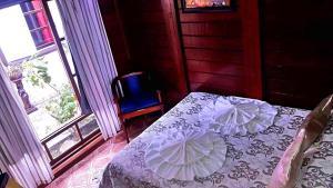 Cama ou camas em um quarto em Recanto Monte Suíço