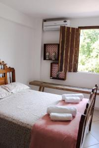 A bed or beds in a room at Casa da Vila