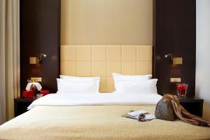 Ein Bett oder Betten in einem Zimmer der Unterkunft MyPlace - Premium Apartments City Centre