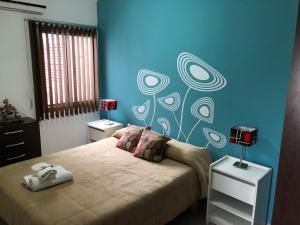 Una cama o camas en una habitación de Departamento Ludmila