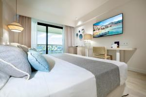 A bed or beds in a room at Grand Palladium Sicilia Resort & Spa