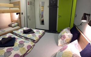 A bed or beds in a room at Hostel Chic