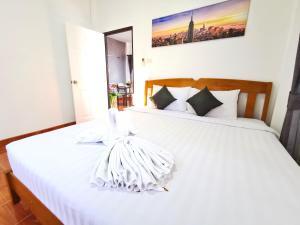 Кровать или кровати в номере Thai Orange Magic