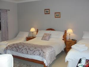 A bed or beds in a room at Newsham Grange Farm