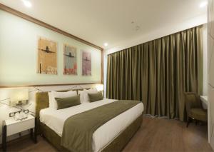 Ένα ή περισσότερα κρεβάτια σε δωμάτιο στο ISG Sabiha Gökçen Airport Hotel