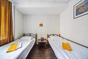 Кровать или кровати в номере Shabolovka Hotel