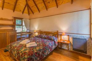 Una cama o camas en una habitación de Aldea Nevada
